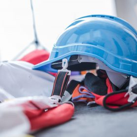 Construction Protection Gear. Plastic Protection Helmet and Gloves Closeup Photo.